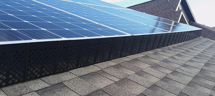 SolaTrim installed on a roof with solar panels.